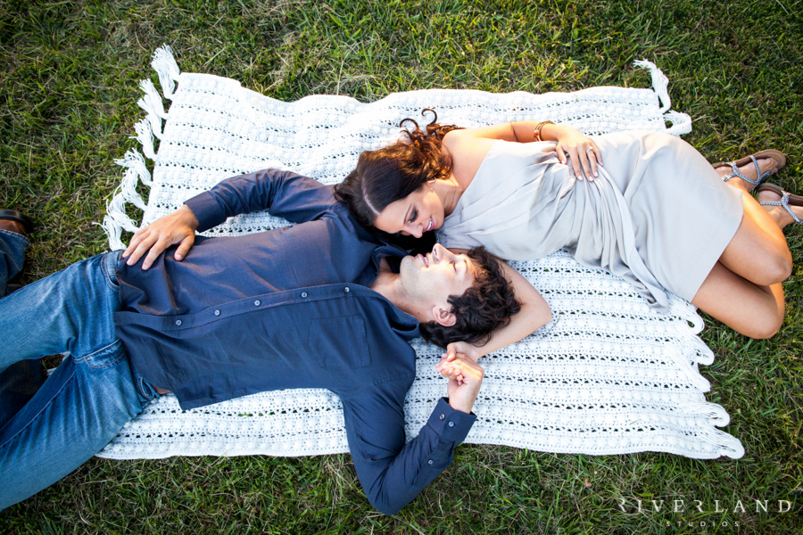 Couple Laying on Blanket in Grass